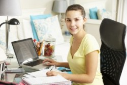 bigstock-Teenage-Girl-Studying-At-Desk-94476794-300x200
